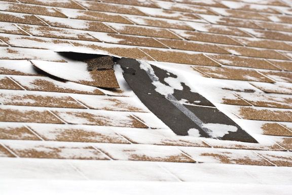 Damaged roof in winter
